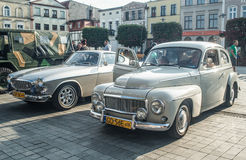 Classic Swedish cars Volvo PV544 B18 and P1800. Beautifully restored Swedish classic automobiles Volvo PV544 B18 and P1800 convertible at a car show in Puck royalty free stock photography