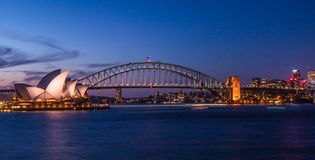 Classic Sydney. Sydney harbour dusk. Australia. Harbour bridge and opera house with light trails of passing Stock Photo