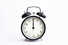 Classic table clock on a white background. Royalty Free Stock Photo