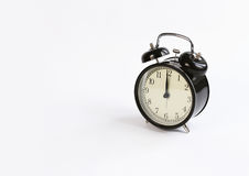 Classic table clock on a white background. Royalty Free Stock Image