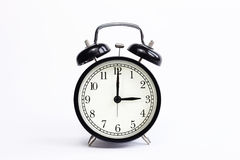 Classic table clock on a white background. Royalty Free Stock Images