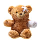 Classic teddy bear with bandages Stock Photo