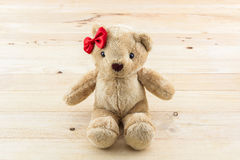 Classic teddy bear red bow toy. Stock Photo