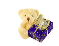 Classic teddy bear sitting with blue gift box on white. Royalty Free Stock Images