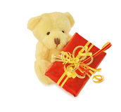Classic teddy bear sitting with red gift box on white. Royalty Free Stock Photo