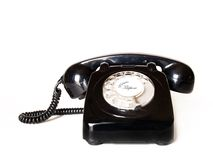 Classic telephone. Old black telephone over white Stock Image