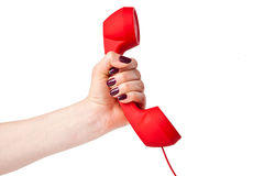 Classic telephone receiver in hand Royalty Free Stock Image