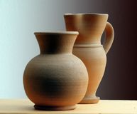 Classic terracotta vase. Two classic terracotta vase on a shade background Stock Images