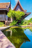 Classic Thai house with pond Royalty Free Stock Photos