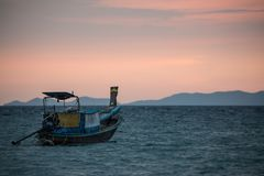 Classic Thailand sunset view with long tail boats Royalty Free Stock Photography