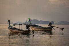 Classic Thailand sunset view with long tail boats Stock Photo