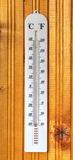 Classic thermometer on wooden board Royalty Free Stock Photos