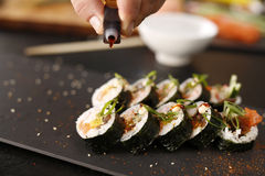 Classic thick rolls futomaki served on a stone plate Royalty Free Stock Photography