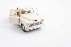 Classic toy car on white. Background Royalty Free Stock Images