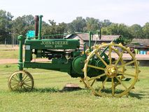 Classic Tractor. An old John Deere tractor in green and yellow in the state of Mississippi Royalty Free Stock Images