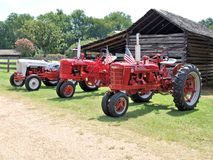 Classic Tractors. Three classic tractors, a Ford Jubilee model and two International Farmalls Stock Photo