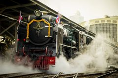 Classic Train led by Steam locomotive Pacific of Thailand Stock Images