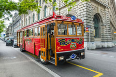 Classic trolley for tourists in overcast rainy weather in Zurich Stock Photos