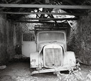 Old brocken truck. In a colapsed warehouse Stock Photos