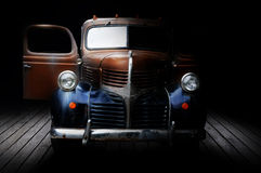 Classic truck. A low key image of an old Dodge truck on a wooden deck with the doors open royalty free stock image
