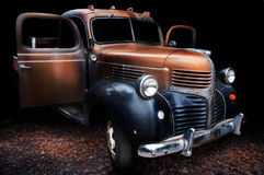 Classic Truck. A classic Dodge truck with doors open and on leafy surface with black background royalty free stock images