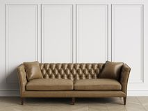 Classic tufted leather sofa in classic interior with copy space. Classic tufted sofa in brown leather  in classic interior with copy space.White walls with Royalty Free Stock Image
