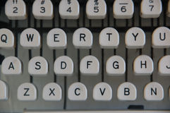 Classic Typewriter Keys. Keys of a classic typewriter showing letters and the buttons of a typewriting machine. White buttons with black capital letters and Royalty Free Stock Photography