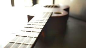 Classic ukulele on leather sofa. Fly over shot stock video