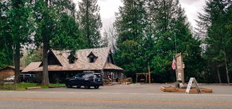 Classic us american roadhouse in the woods. Classic us american roadhouse diner rest house in the woods stock image