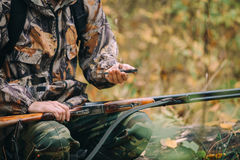 Classic vertical two barrels hunting rifle. Hunter with compass. Classic vertical two barrels hunting rifle stock photo