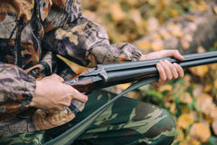 Classic vertical two barrels hunting rifle. In hunters hand Stock Photography