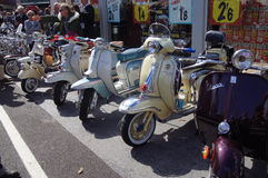 Classic Vespa and Lambretta scooters Stock Image