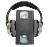 An  classic videotape VHS and wireless headphones. Stock Image