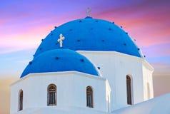 Classic view of blue dome church in Santorini. Perissa Village, Greece Stock Photo
