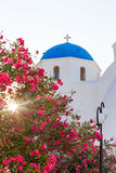 Classic view of blue dome church in Santorini. Stock Photo