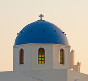 Classic view of blue dome church in Santorini. Stock Images