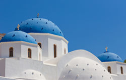 Classic view of blue dome church in Santorini. Royalty Free Stock Photos