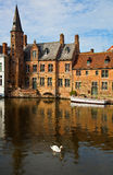 Classic view of channels of Bruges. Belgium. Stock Photos