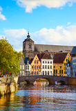 Old colorful buildings behind the bringe in sunny autumn day in Stock Photography