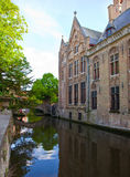 Classic view of channels of Bruges. Royalty Free Stock Images