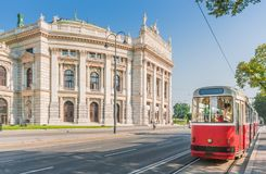 Wiener Burgtheater with traditional tram, Vienna, Austria. Classic view of famous Wiener Ringstrasse with historic Burgtheater Imperial Court Theatre and Stock Photos