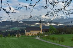 Classic view of famous Wilparting Pilgrimage Church with green meadows and trees in springtime, Irschenberg, Upper Stock Images