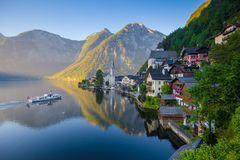 Classic view of Hallstatt with ship at sunrise, Salzkammergut, A royalty free stock photos