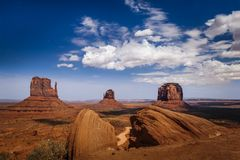 Classic View of Monument Valley and American West. The Mittens and Merrick Butte with Ansel Adams rocks Royalty Free Stock Images