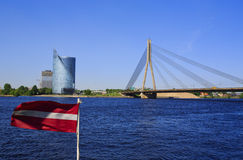 Classic view of Riga Bridge. With Latvian Flag Royalty Free Stock Images
