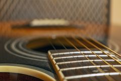 Classic vintage acoustic guitar with visible frats and wires. Close-up view royalty free stock photos