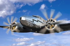 Classic Vintage Airplane Flight, Flying Aviation. Artist rendition of a classic vintage aircraft in flight. An old prop airplane flies through a blue sky filled Stock Photography