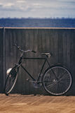 Classic Vintage Black Bicycle Leaning Against Wall Royalty Free Stock Photography