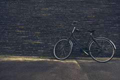 Classic Vintage Black Hipster Bicycle on the Street Royalty Free Stock Image