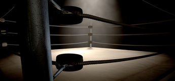 Classic Vintage Boxing Ring Corner. A closeup of the corner of an old vintage boxing ring surrounded by ropes spotlit by a spotlight on an  dark background Royalty Free Stock Photography
